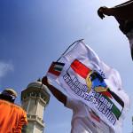 Komite Nasional Rakyat Palestina melakukan aksi peduli Gaza di depan Masjid Raya Baturrahman (Foto M Iqbal/SeputarAceh.com)
