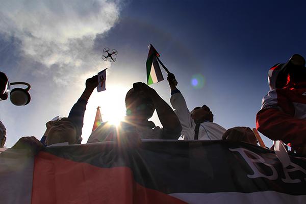 Ada cincin matahari saat aksi peduli korban serangan roket Israel. (Foto M Iqbal/SeputarAceh.com)